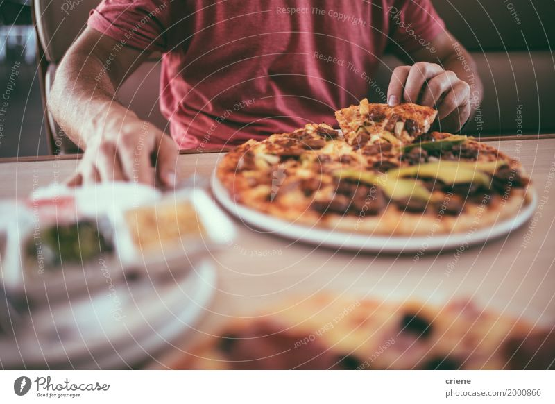 Close-up of man eating delicious pizza for lunch in restaurant Food Dough Baked goods Eating Lunch Dinner Fast food Finger food Crockery Plate Lifestyle Table