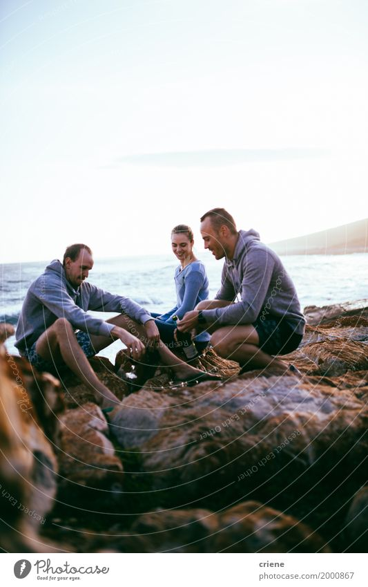 Young adult friends having fun together on rocks Woman Vacation & Travel Youth (Young adults) Man Summer Ocean Joy Adults Lifestyle Group Tourism Rock Together Friendship Glass Sit