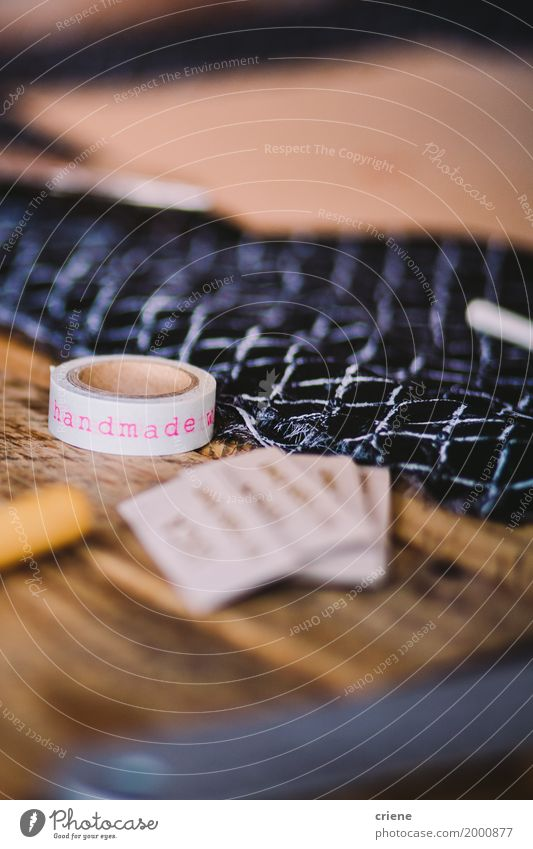 "Close-up of tape which has ""handmade"" written on Lifestyle Design Leisure and hobbies Handcrafts Desk Table Profession Workplace Business SME Art Artist"