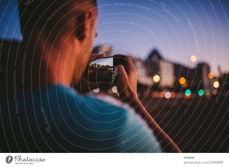 Young cauacasian man taking photo with smart phone at night Youth (Young adults) Man Hand Joy Adults Lifestyle Copy Space Masculine Modern Technology Telephone Internet Cellphone Camera PDA Take a photo