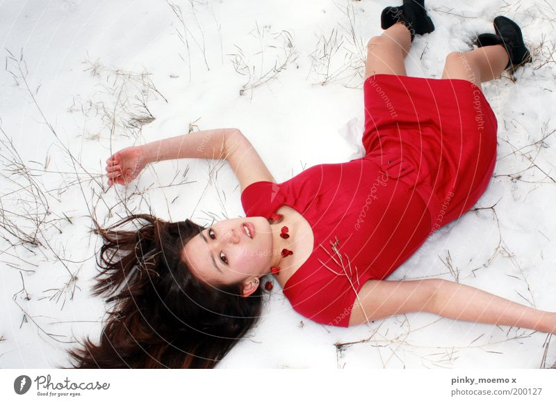 small cooling Human being Young woman Youth (Young adults) Woman Adults 1 Nature Snow Lie Red White Cold Exterior shot Experimental Day Light Shadow Contrast
