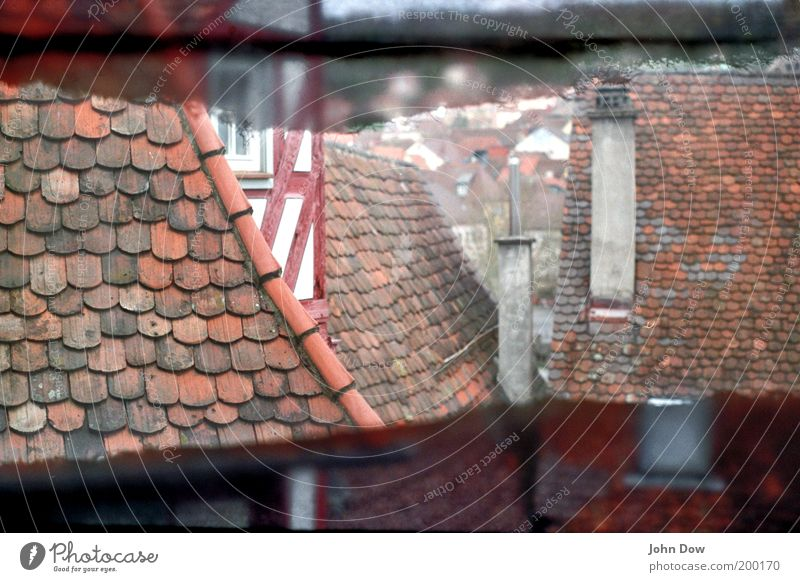 Analog Roofs City trip Living or residing Old town House (Residential Structure) Manmade structures Building Facade Chimney Esthetic Historic Red Past