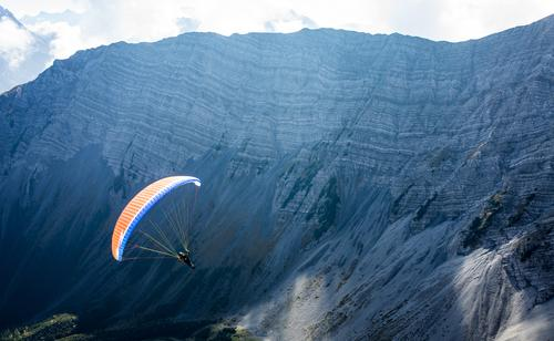 Paragliding in the Alps, Lermoos, Zugspitzarena Leisure and hobbies Tourism Flying 1 Human being Nature Landscape Air Autumn Rock Mountain Peak Hiking Authentic