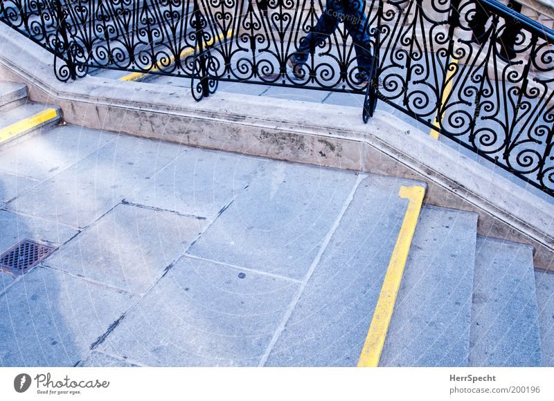 Between the lines Masculine Legs Stairs Banister Landing Newel Line Yellow Gray Downward Wrought iron Grating Colour photo Subdued colour Exterior shot Close-up