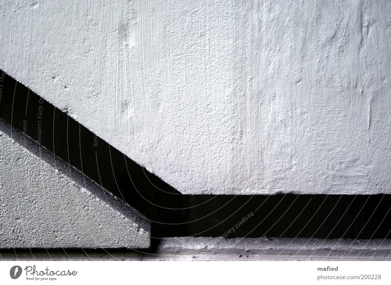 mind the gap House (Residential Structure) Manmade structures Building Architecture Wall (barrier) Wall (building) Stairs Concrete Gray Black White Colour photo