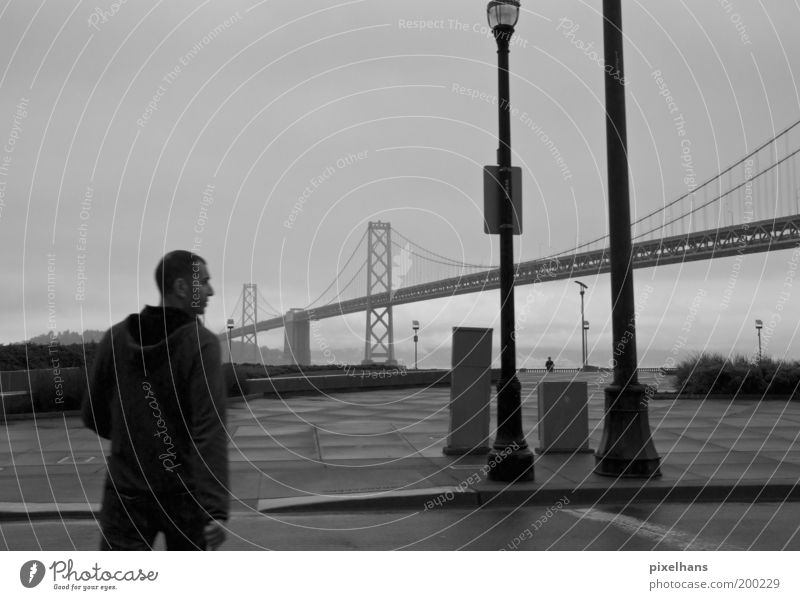 Left - Right - View Sightseeing City trip Jacket Short-haired Going Fog Lantern Bridge Street San Francisco Rain Street lighting Man 1 Black & white photo