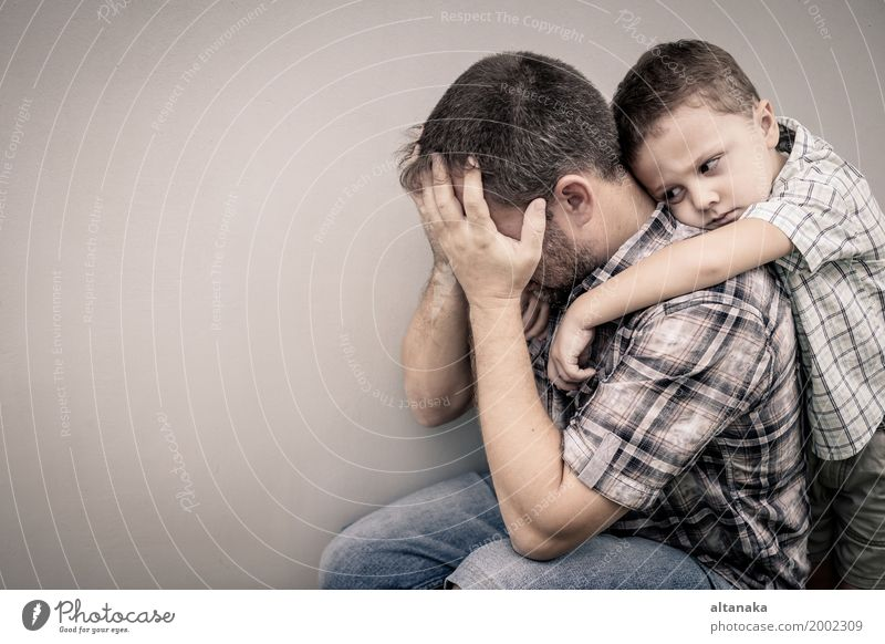 sad son hugging his dad near wall Face Child Boy (child) Man Adults Parents Father Family & Relations Infancy Sadness Embrace Cry Together Emotions Concern