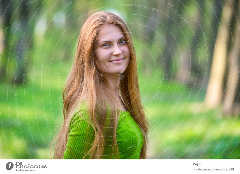Pretty happy woman with red long hair Human being Woman Nature Youth (Young adults) Summer Young woman Beautiful Green Tree Red Joy Forest 18 - 30 years Face Adults Yellow