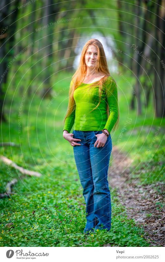Pretty happy woman with red long hair Human being Woman Nature Youth (Young adults) Plant Blue Summer Young woman Beautiful Green Tree Red Joy Girl Forest