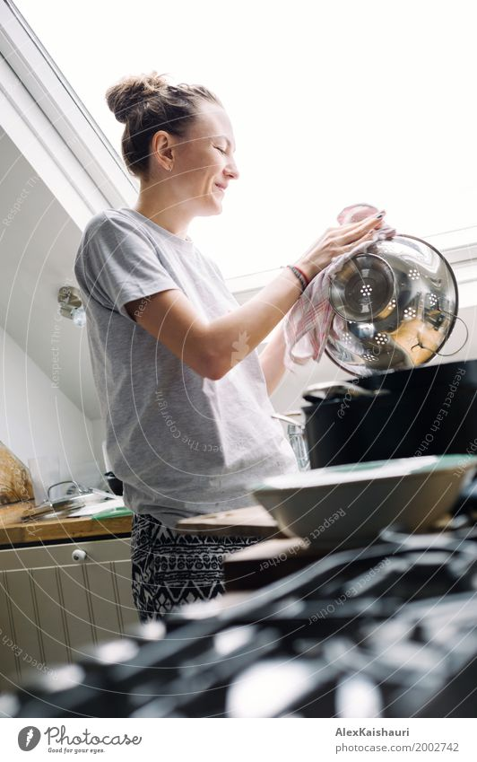Happy woman doing the dishes in modern sunny kitchen. Human being Youth (Young adults) Young woman House (Residential Structure) Joy Window 18 - 30 years Adults