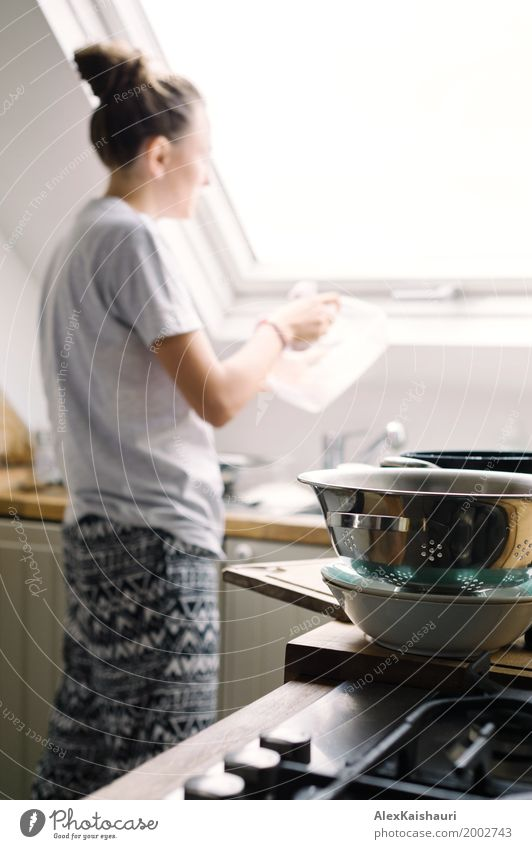 Young housewife washing the dishes Human being Youth (Young adults) Young woman House (Residential Structure) Joy 18 - 30 years Adults Life Lifestyle
