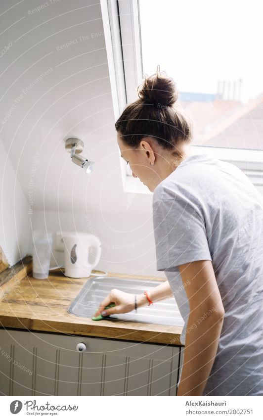 Young woman do the cleaning in modern minimal kitchen. Human being Woman Youth (Young adults) Summer Loneliness House (Residential Structure) Window