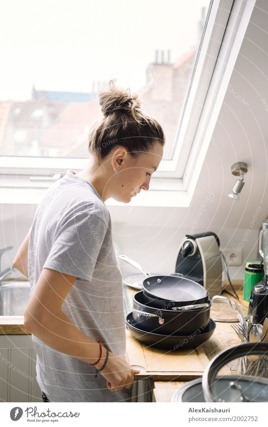 Sad female finished doing the dishes in shiny kitchen room. Human being Woman Youth (Young adults) 18 - 30 years Adults Mother Sister