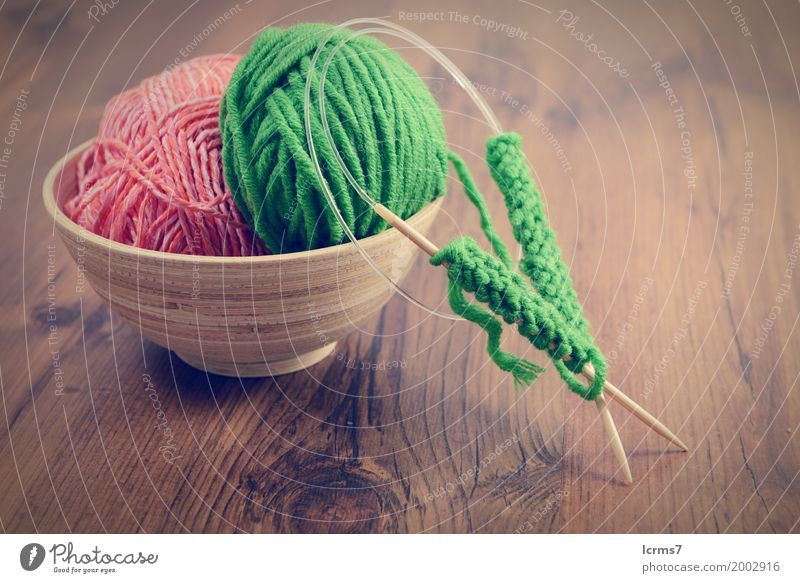 knitting with green wool in a bowl on wooden table Design Leisure and hobbies Winter Warmth Fashion Wool Knit Creativity creased yarn craft Background picture