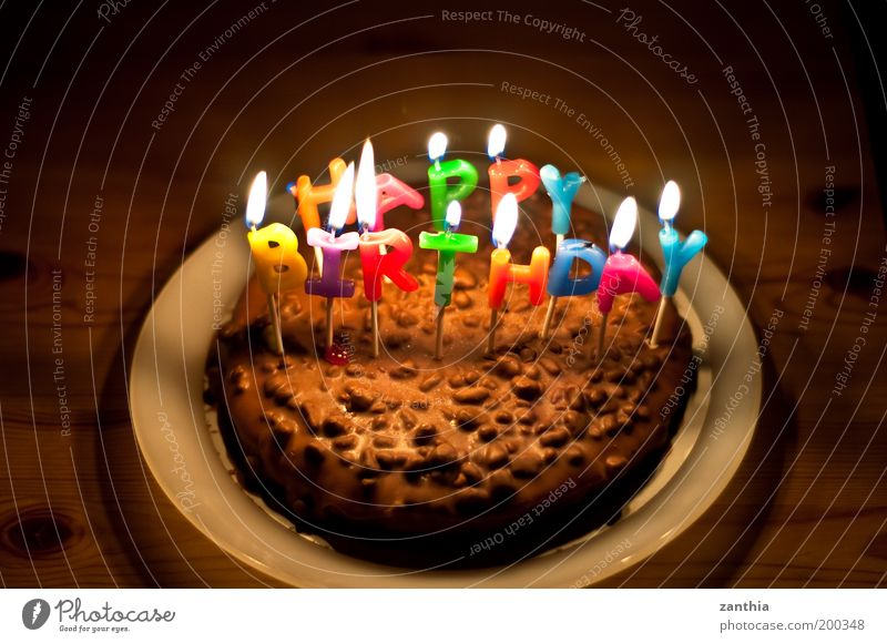 Happy Birthday Feasts & Celebrations Old To enjoy Illuminate Sweet Brown Multicoloured Black Emotions Joy Surprise Colour Infancy Desire Birthday cake Candle