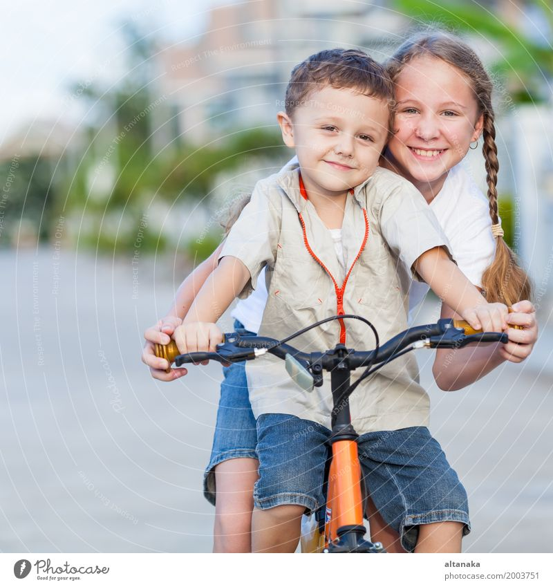 Happy kids with bike standing on the road at the day time. Human being Child Nature Summer Joy Girl Lifestyle Love Emotions Sports Boy (child) Laughter