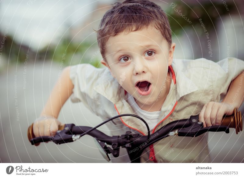 Happy little boy with bicycle Human being Child Nature Man Summer Relaxation Joy Adults Street Lifestyle Sports Boy (child) Family & Relations Small