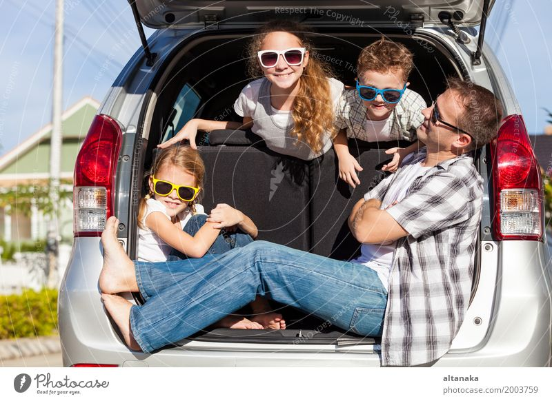 Happy family getting ready for road trip on a sunny day. Human being Child Nature Vacation & Travel Man Summer Joy Girl Adults Street Lifestyle Boy (child)