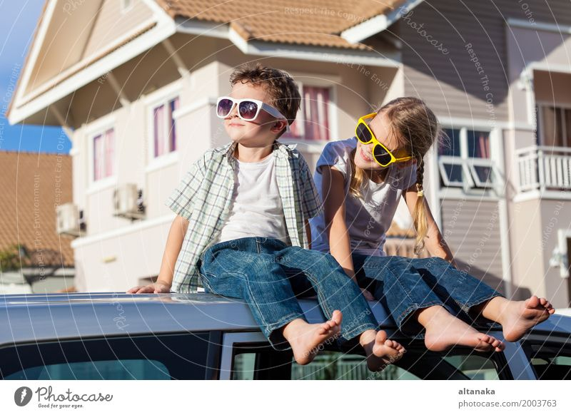Happy children getting ready for road trip on a sunny day. Human being Child Nature Vacation & Travel Summer Joy Street Lifestyle Boy (child) Family & Relations Playing Happy Freedom School Together Friendship