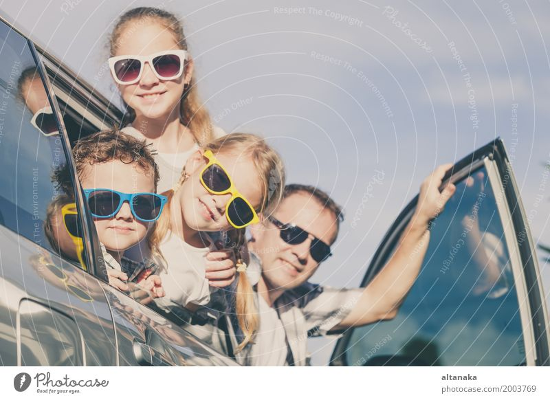 Happy family getting ready for road trip on a sunny day. Concept of friendly family. Lifestyle Joy Leisure and hobbies Vacation & Travel Trip Adventure Freedom