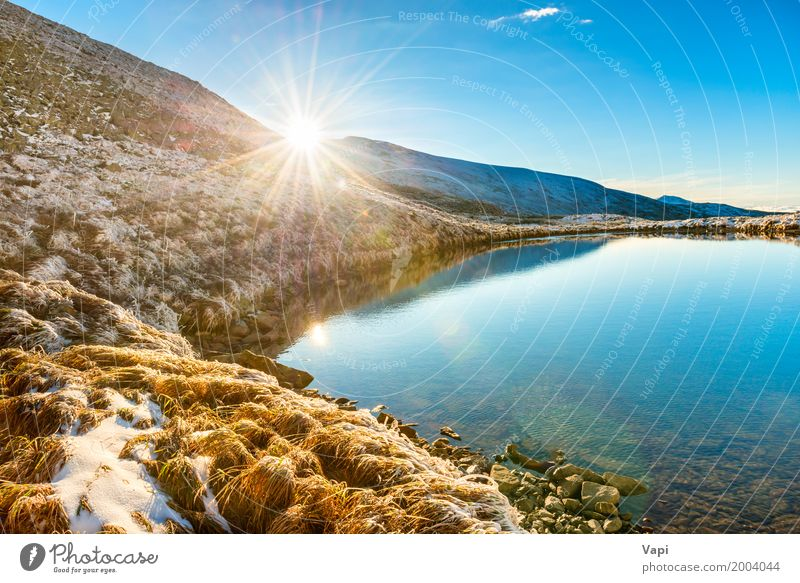 Beautiful blue lake in the mountains Vacation & Travel Tourism Freedom Summer Summer vacation Sun Winter Snow Mountain Environment Nature Landscape Water Sky