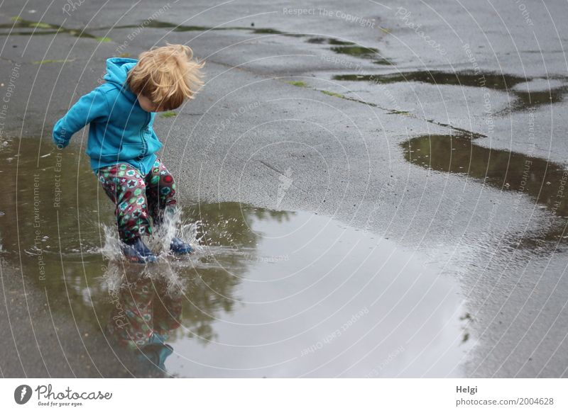 little boy with colorful pants and blue jacket jumps into a puddle Human being Masculine Toddler Infancy 1 1 - 3 years Environment Water Summer Clothing Pants