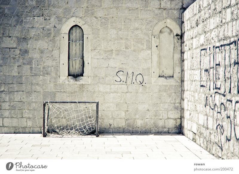 Wall (building) Window Stone Wall (barrier) Building Warmth Graffiti Soccer Bright Facade Empty Church Castle Manmade structures Sports Art