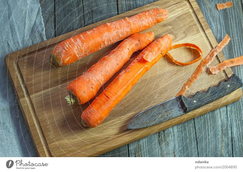 Whole carrots on a kitchen cutting board Vegetable Nutrition Eating Vegetarian diet Diet Table Wood Fresh Above Produce Vegan diet agriculture Organic orange