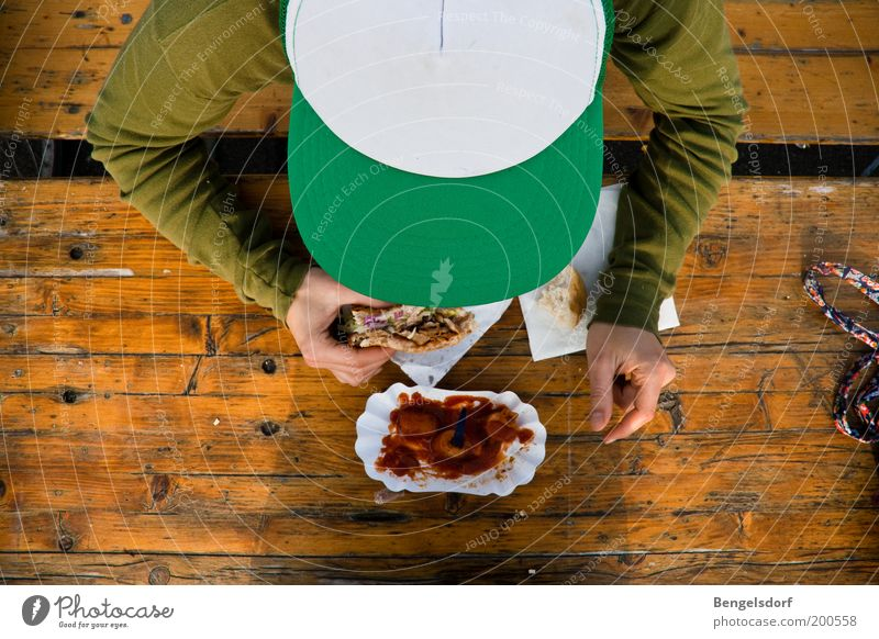 Human being Man Youth (Young adults) Green Nutrition Adults Eating Masculine Food Bench Bird's-eye view Vegetable Appetite Cap Bread Meat