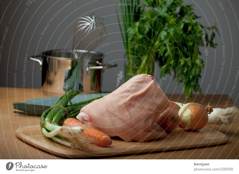 still lifes knuckle of pork Meat Knuckle Raw Vegetable Carrot Onion Leek Beater Pot Chives Parsley Early onion Fat Food Nutrition Table Chopping board Cooking