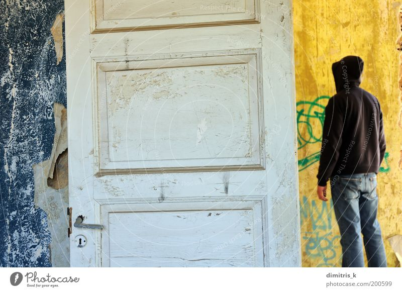 hooded figure Human being Man Blue Old White Loneliness Adults Yellow Graffiti Wall (building) Wall (barrier) Time Background picture Room Door Dirty