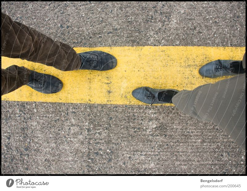 Human being Man Adults Yellow Emotions Gray Happy To talk Legs Couple Friendship Feet Line Together Footwear Concrete