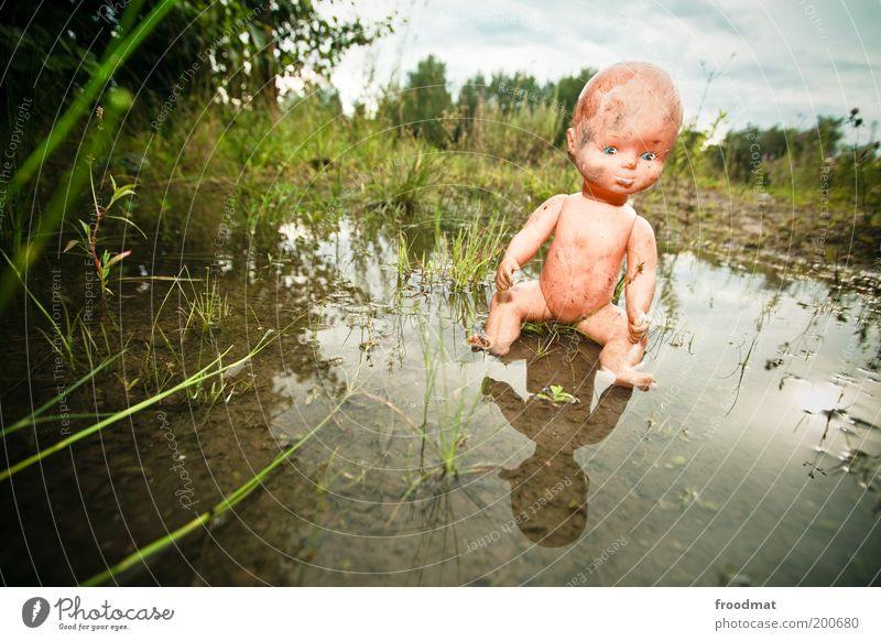 puppet phobia Water Toys Doll Sit Threat Creepy Trashy Fear Bizarre Whimsical Surrealism Dream Decline Past Transience Alarming Dirty Puddle Naked Abuse
