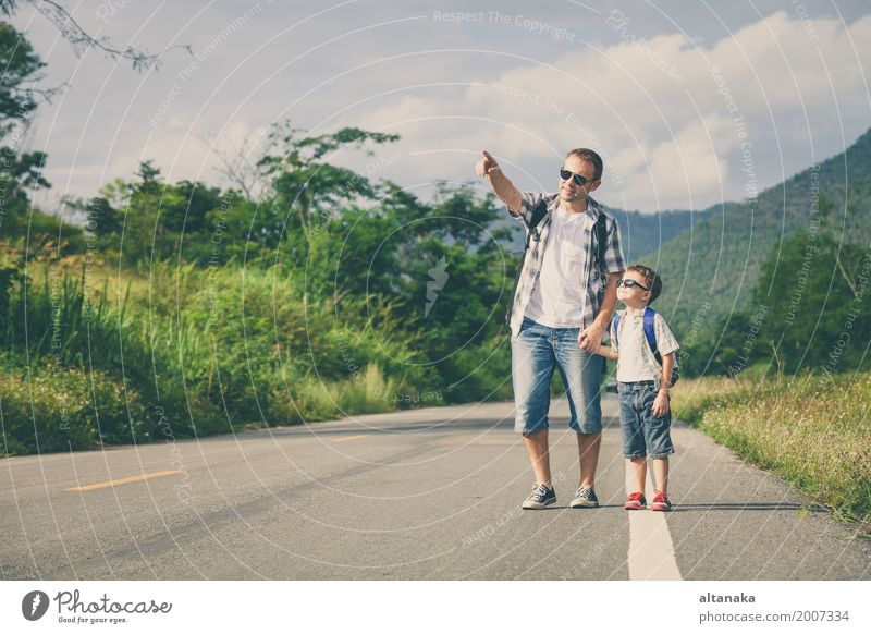 Father and son walking on the road at the day time Human being Child Nature Vacation & Travel Man Summer Joy Mountain Adults Street Lifestyle Love Sports