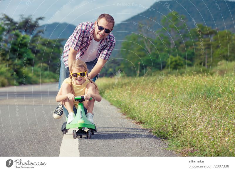 Father and daughter playing on the road at the day time. Lifestyle Summer Hiking Human being Child Girl Man Adults Family & Relations 2 3 - 8 years Infancy