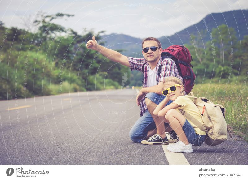Father and daughter walking on the road at the day time. Lifestyle Joy Happy Leisure and hobbies Vacation & Travel Trip Adventure Freedom Summer Mountain Hiking
