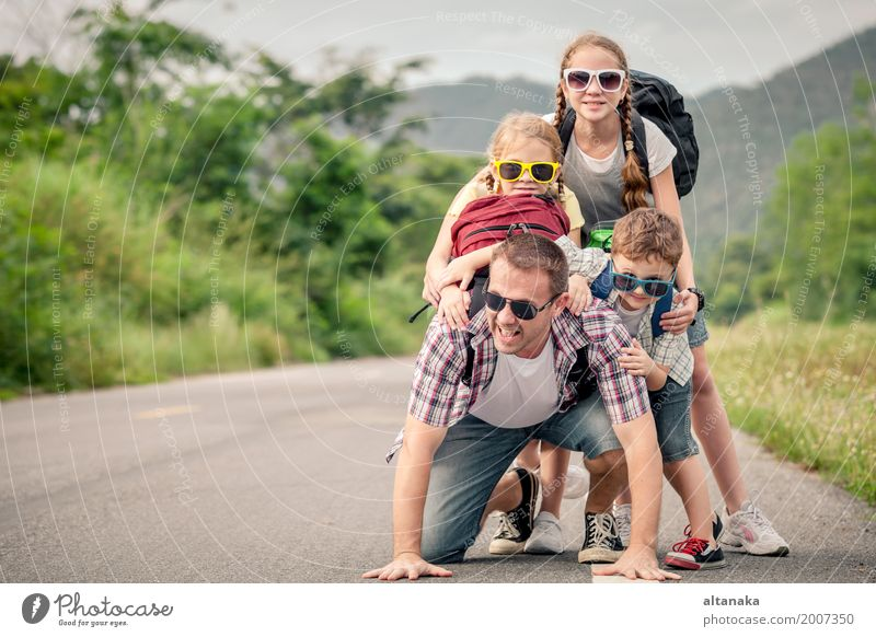 Father and children walking on the road at the day time. Human being Child Nature Vacation & Travel Man Summer Joy Mountain Adults Street Lifestyle Love Sports Boy (child) Family & Relations Happy