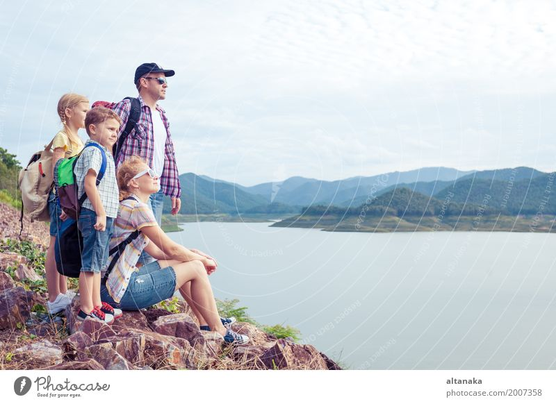 Happy family standing near the lake at the day time. Healthy Hiking Human being Child Woman Adults Man Parents Mother Father Brother Sister Friendship Smiling