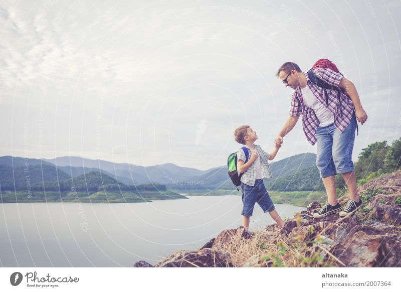 Father and son standing near the lake at the day time. Human being Child Nature Vacation & Travel Man Summer Joy Mountain Adults Lifestyle Love Sports