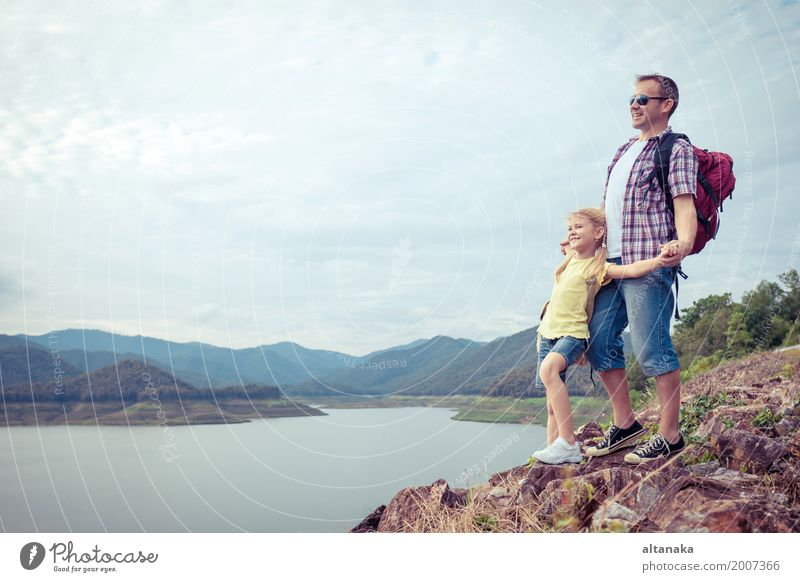 Father and daughter standing near the lake at the day time. Human being Child Nature Vacation & Travel Man Summer Joy Girl Mountain Adults Lifestyle Love Sports