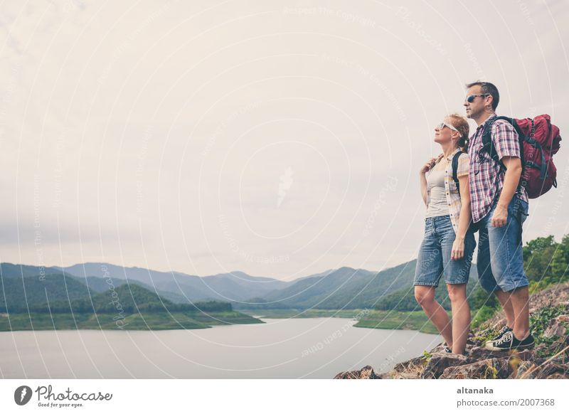 Happy family standing near the lake at the day time. Human being Nature Vacation & Travel Man Summer Relaxation Joy Beach Mountain Adults Lifestyle Love Sports