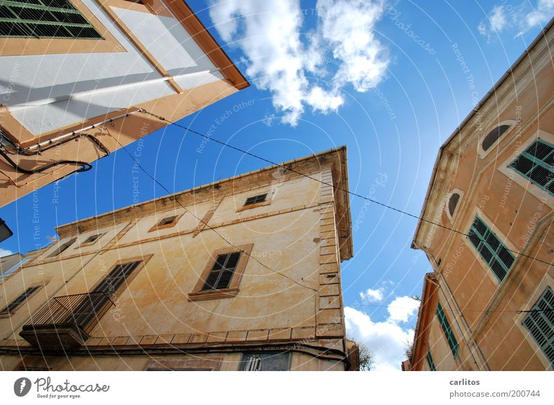 The earth is a sphere Small Town Downtown House (Residential Structure) Manmade structures Facade Balcony Window Old Esthetic Sharp-edged Historic Above Under