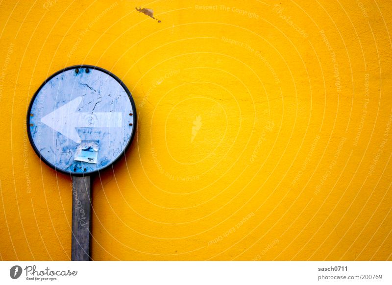 left outside Street Road sign Sign Arrow Old Bright Round Blue Yellow Colour Decline Transience Colour photo Exterior shot Deserted Copy Space right