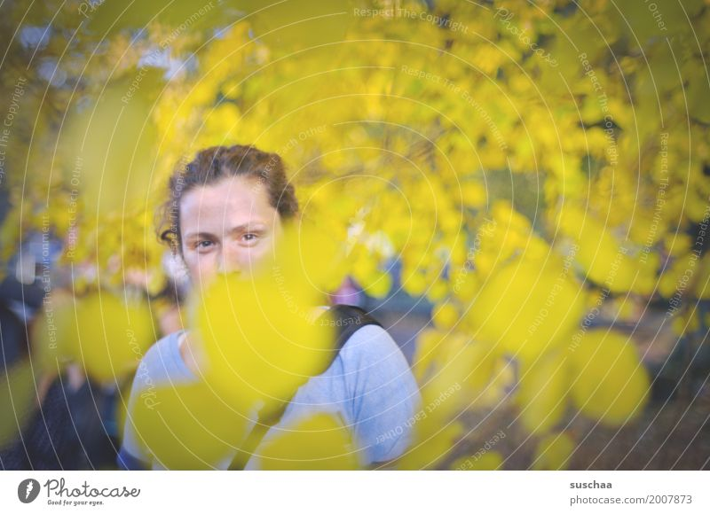 It's been a long time. Woman Young woman Face Concealed Eyes 1 Person feminine Leaf Autumn Exterior shot Leisure and hobbies Yellow To go for a walk Hiking