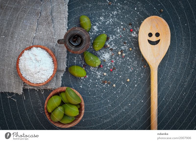 Green olives and salt in wooden bowls, top view Nature Plant Green White Black Natural Wood Above Fruit Nutrition Fresh Table Delicious Vegetable Berries Bowl