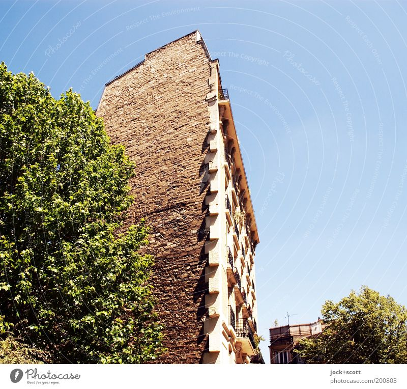Parisian Chic & Cut Cloudless sky Town house (City: Block of flats) Wall (building) Facade Old building Brick Protection Nostalgia Safety Structures and shapes