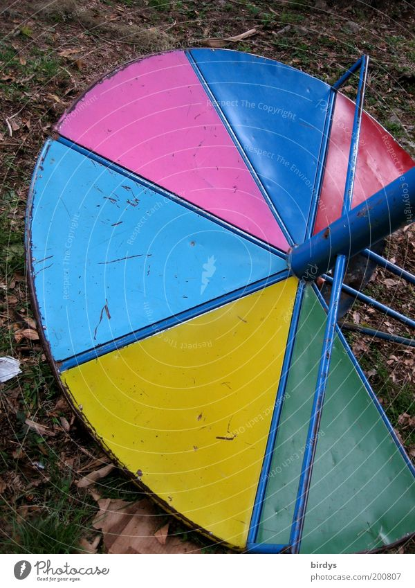 Playful !? Playground Metal Broken Blue Multicoloured Yellow Green Pink Red Transience Contrast Gyroscope Potter's wheel Round Colour photo Exterior shot