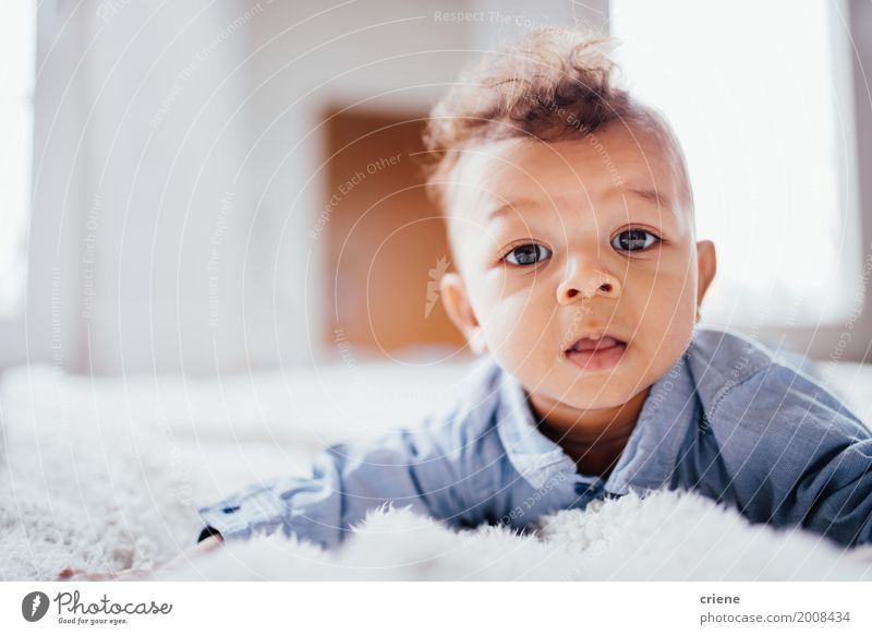 Cute male toddler laying on bed looking at camera Lifestyle Happy Child Masculine Baby Toddler Boy (child) Infancy 0 - 12 months Smiling Bright Small Offspring