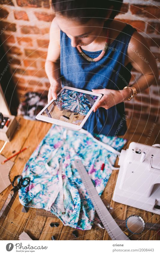 Young female blogger taking photo of dress with tablet Youth (Young adults) Young woman Feminine Business Fashion Design Work and employment Office Technology