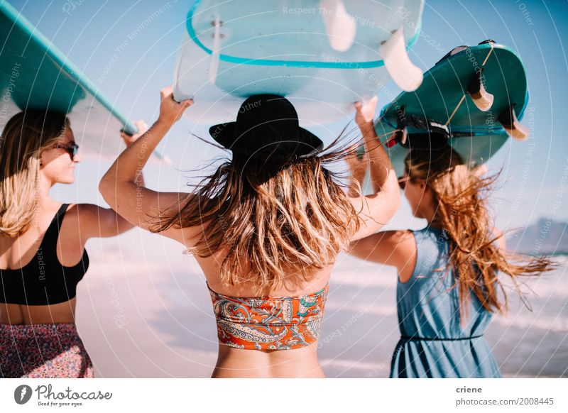 Group of young adult women carrying surfboards at beach Woman Vacation & Travel Youth (Young adults) Summer Young woman Sun Ocean Relaxation Joy Beach Adults
